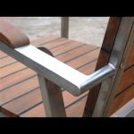 Designer arm rest in teak and stainless steel